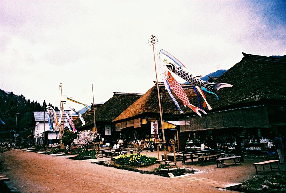 Koinobori, carp streamer, with thatched roof Japanese traditional houses in Ouchijuku, Fukushima.