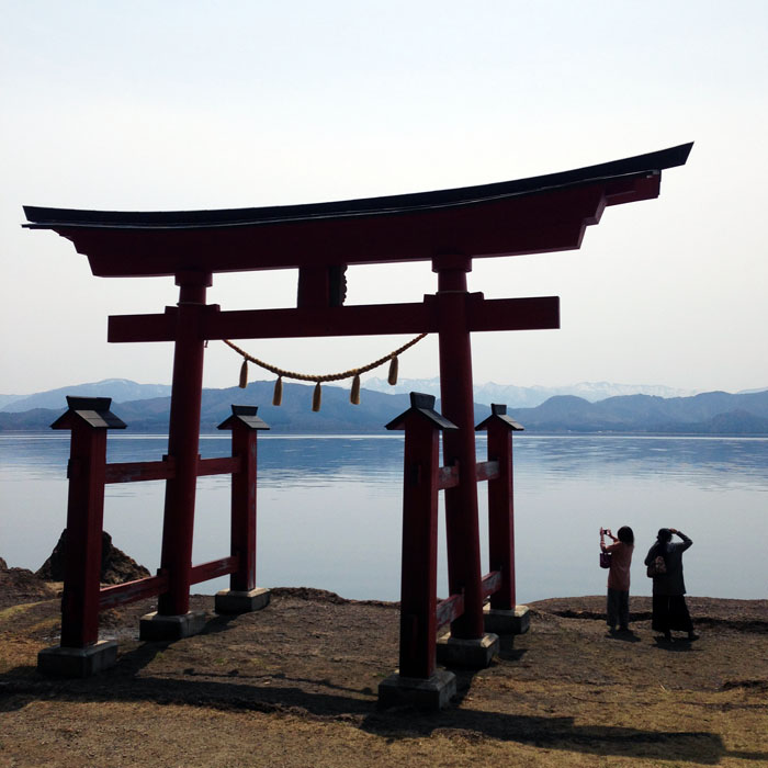 Torii, Shinto Shrine Gate, of Gozanoishi Shrine on the Lake Tazawa.